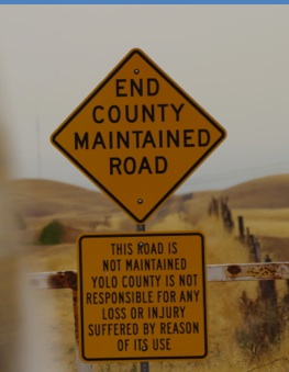 "Road Signs ""End County Maintained Road"" ""This road is not maintained Yolo county is not responsible for any loss or injury suffered by reason of its use"""