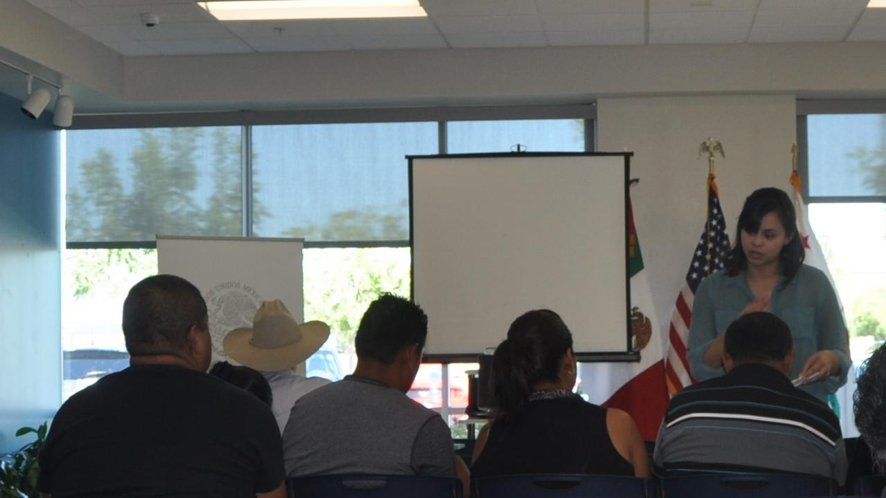 Outreach staff giving a heat illness presentation at the Mexican Consulate