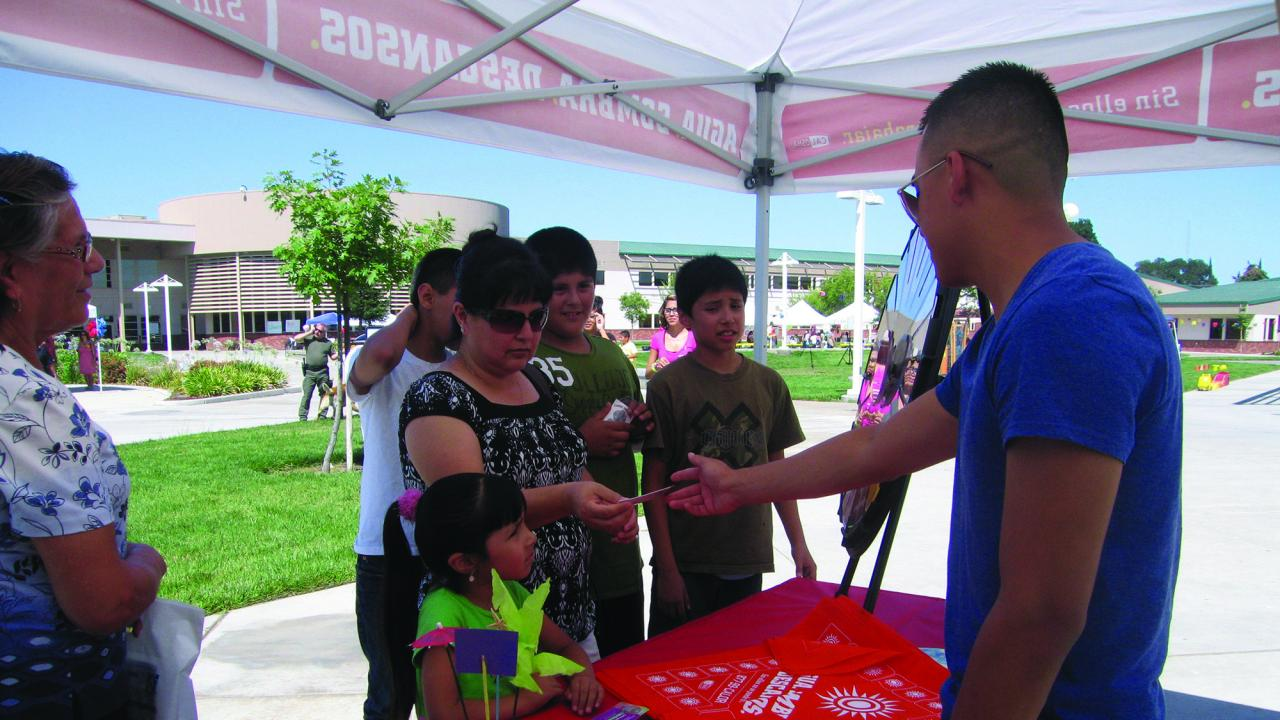 Outreach worker engages with the community at a health fair