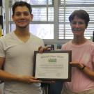 Javier Castro and Diane Mitchell hold Best Research Paper certificate