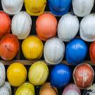 Colorful collection of construction safety helmets